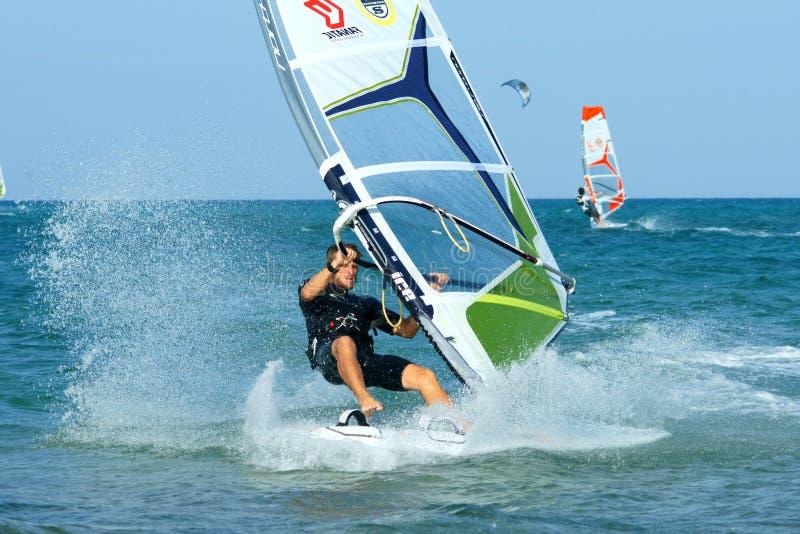 Windsurfing freestyle. Windsurfer making freestyle elements on flat water royalty free stock photography