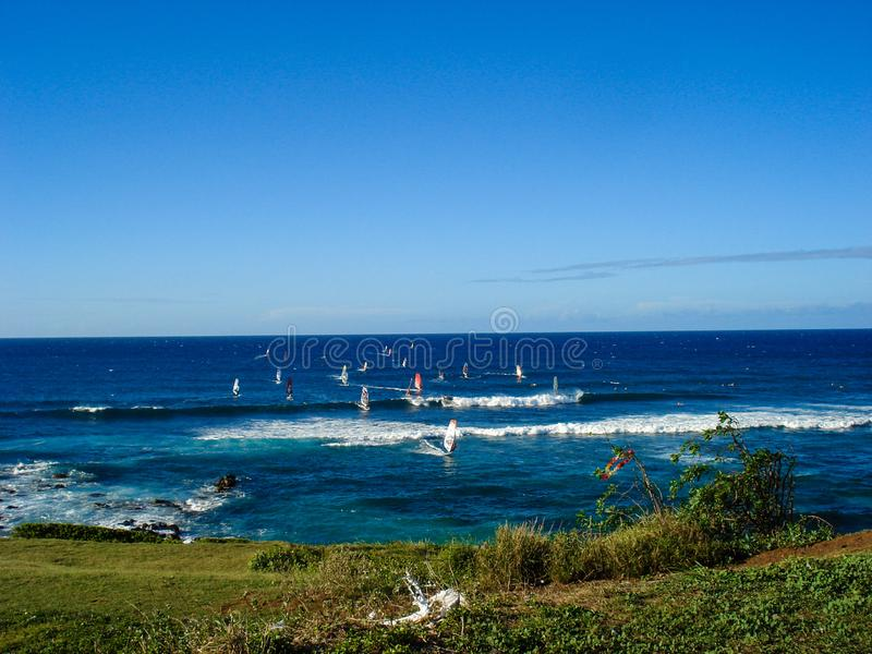 Windsurfing on the island of Maui, Hawaii stock photography
