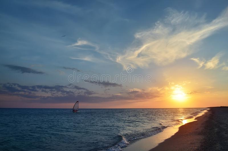 Windsurfing at sea during sunset royalty free stock images