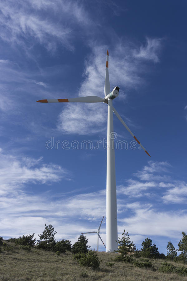 Windturbine against blue sky stock photo