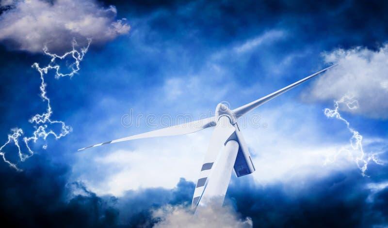Windturbine mot stormmoln arkivfoto