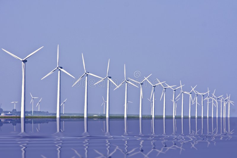 Windturbines at the IJsselmeer in Holland. Windturbines at the IJsselmeer in the Netherlands royalty free stock photos