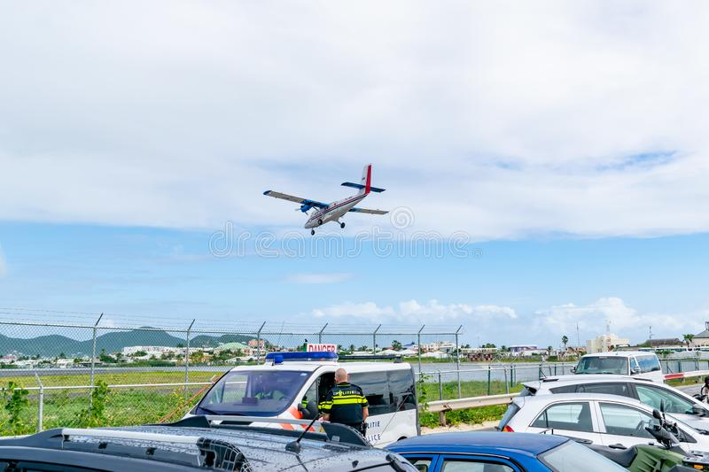 Windward Islands Airways WinAir twin otter DHC-6-300 aircraft preparing to land at Princess Juliana International Airport. Philipsburg, St Maarten - November 16 stock photos