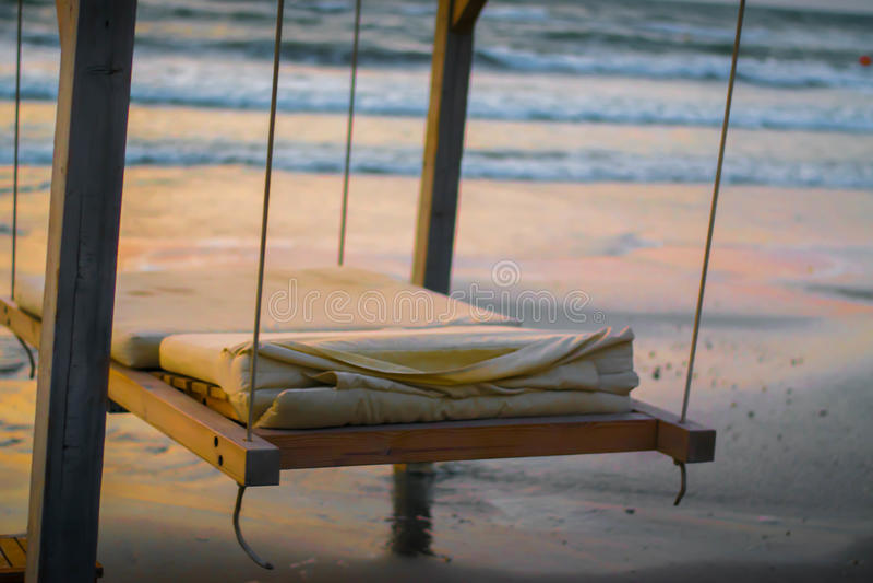 A windy beach. A beach full with umbrellas on a windy day stock photos