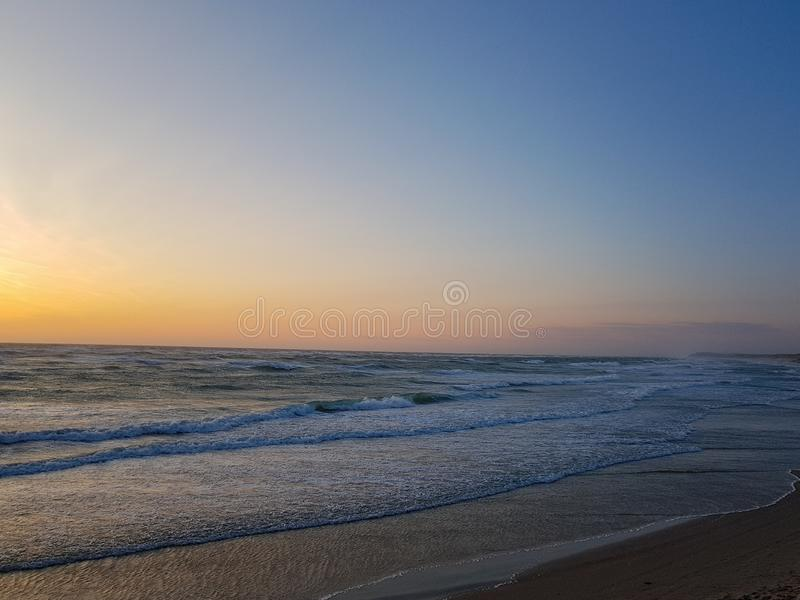 Windy Sunset at the beach in løkken, Denmark. Colorful and moody light from the sun. stock images