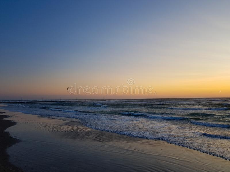 Windy Sunset at the beach in løkken, Denmark. Colorful and moody light from the sun. royalty free stock image