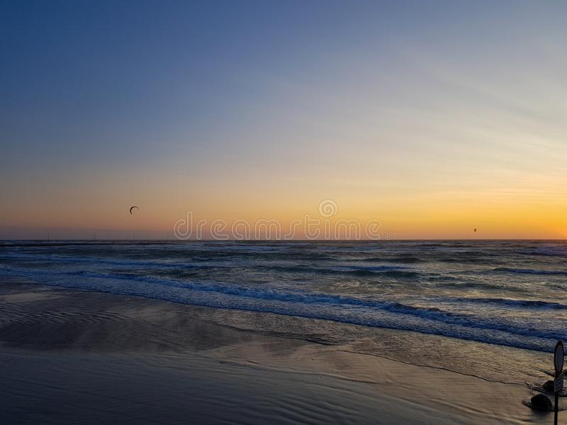 Windy Sunset at the beach in løkken, Denmark. Colorful and moody light from the sun. stock photos