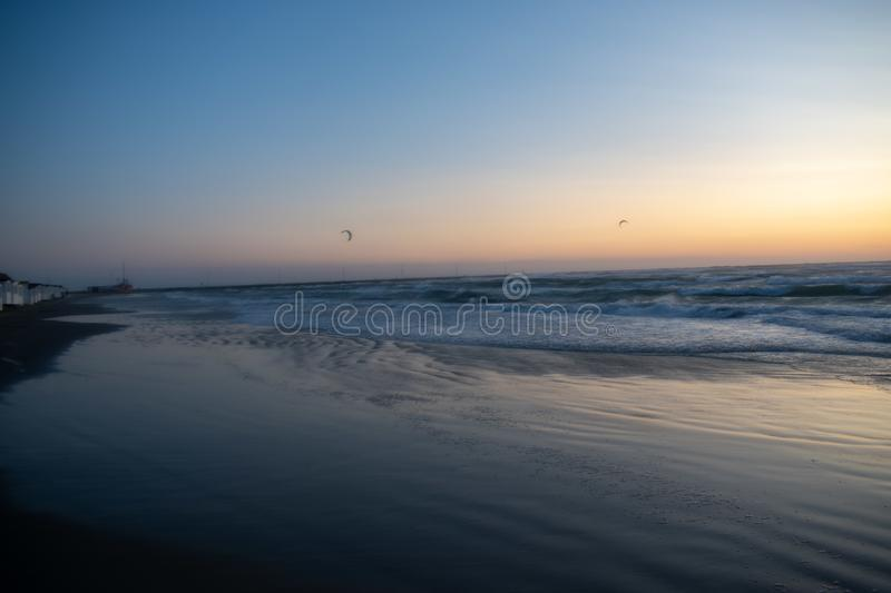Windy Sunset at the beach. Løkken Denmark. Colorful and moody light from the sun. Waves from  the ocean royalty free stock photos