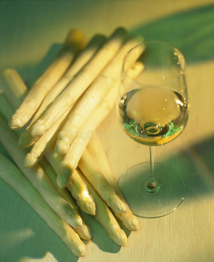 Wine with asparagus royalty free stock image