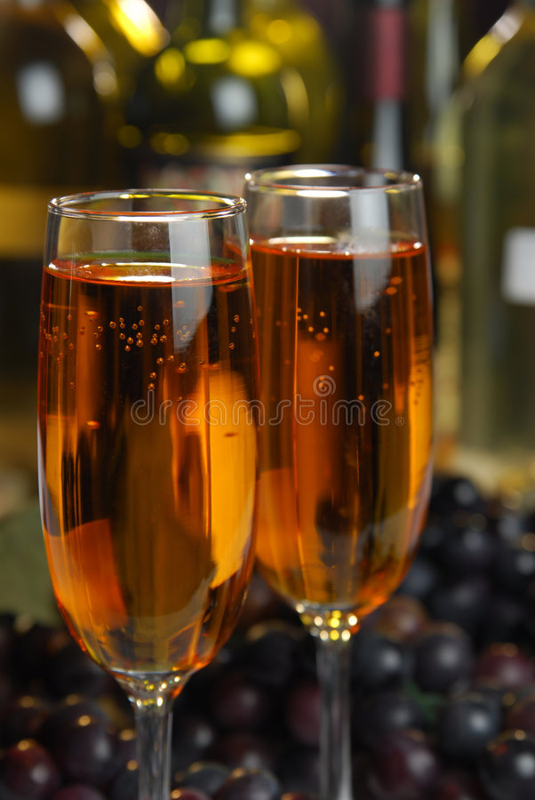 Wine Bar. Two flutes of golden wine in a bar stock photos