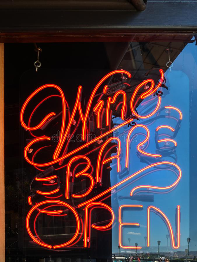 The wine bar is open. Neon sign, the wine bar is open stock photos