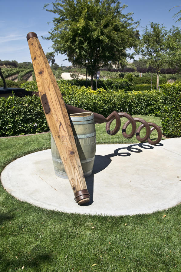 Wine Barrel and Corkscrew. Artwork at a winery in Paso Robels California of a wine barrel and a giant corkscrew with a vineyard in the background stock images