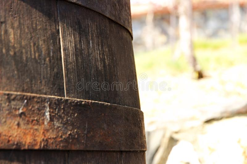 Wine barrel detail. Detail texture wooden barrel for wine, iron hoops on a barrel of wine stock photo