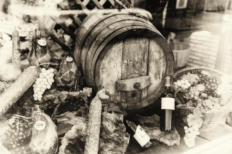 Wine barrel and dried meat assortment in vintage setting. Black and white concept stock photos