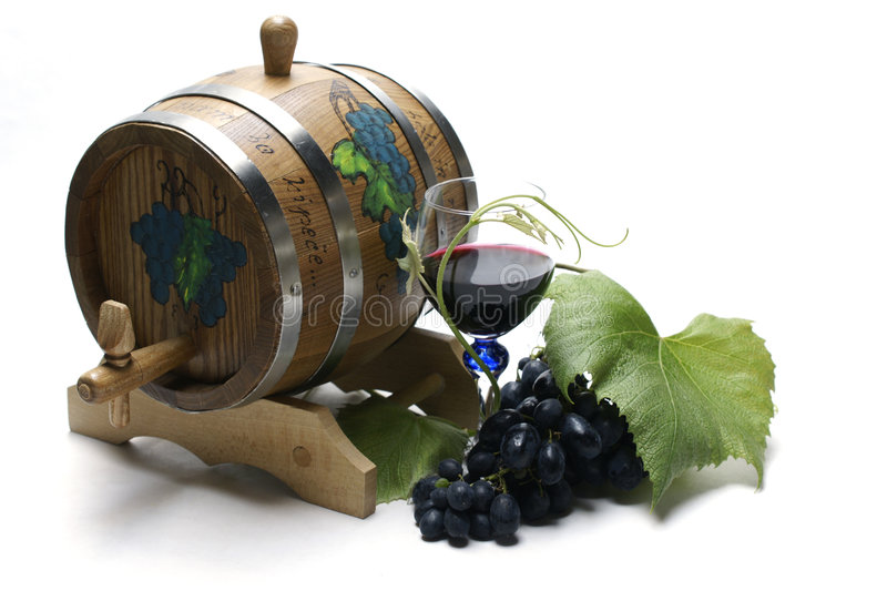 Wine barrel and grapes. Isolated on white background stock image