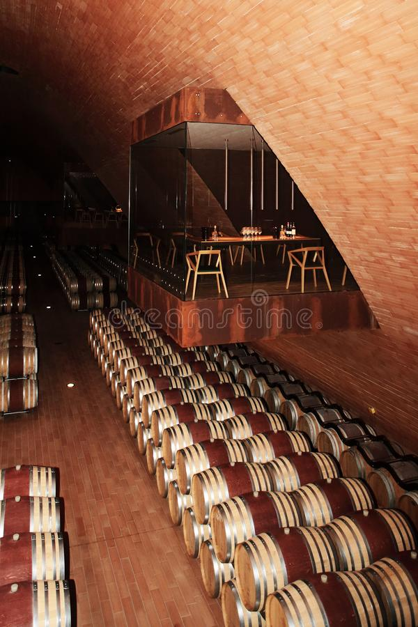 Wine barrel waiting the end of maturing process. Into warehouse with controlled temperature royalty free stock photo