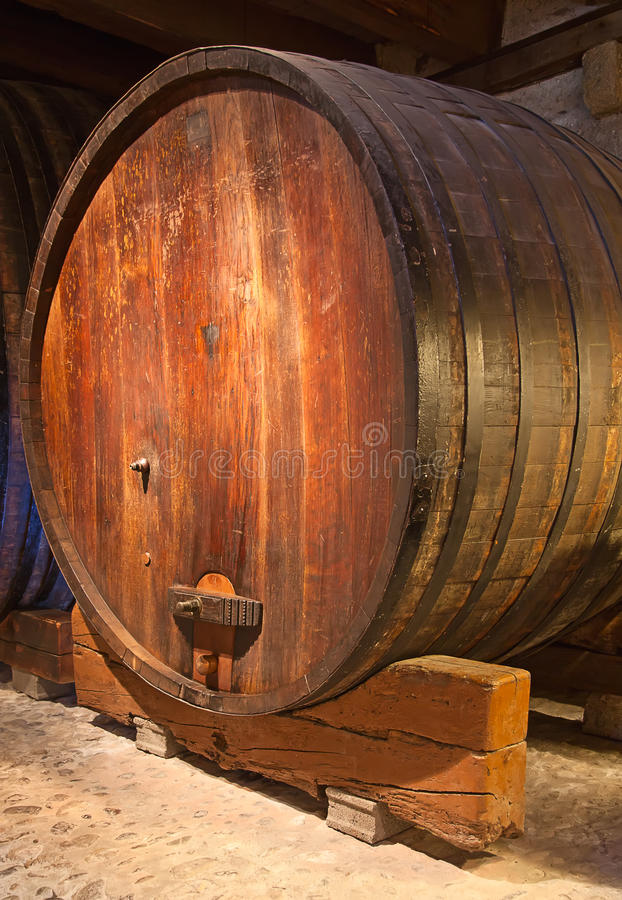 Wine barrels. In the ancient warehouse royalty free stock photos