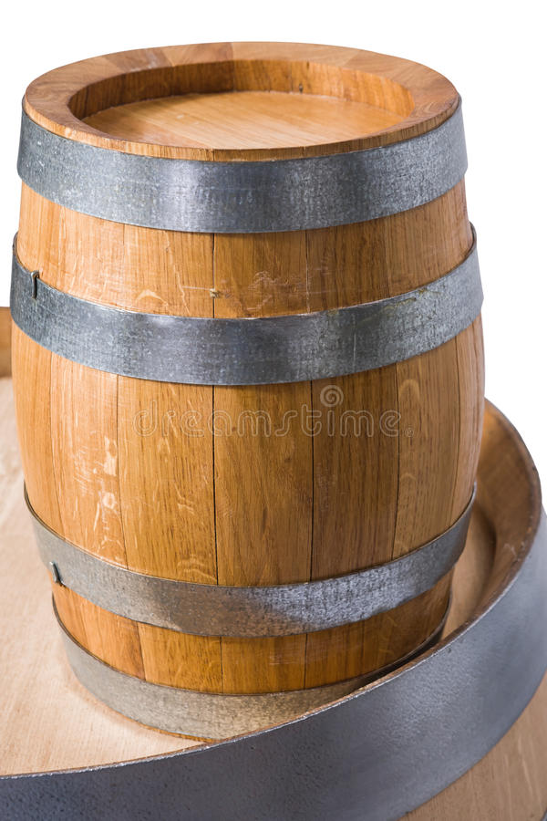 Wine barrels. A small wine barell on the top of a bigger one royalty free stock photography