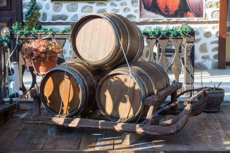 Wine barrels in the street in the town of Melnik Bulgaria. Melnik - the smallest town in Bulgaria. Located in the south in the valley of limestone rocks of stock images