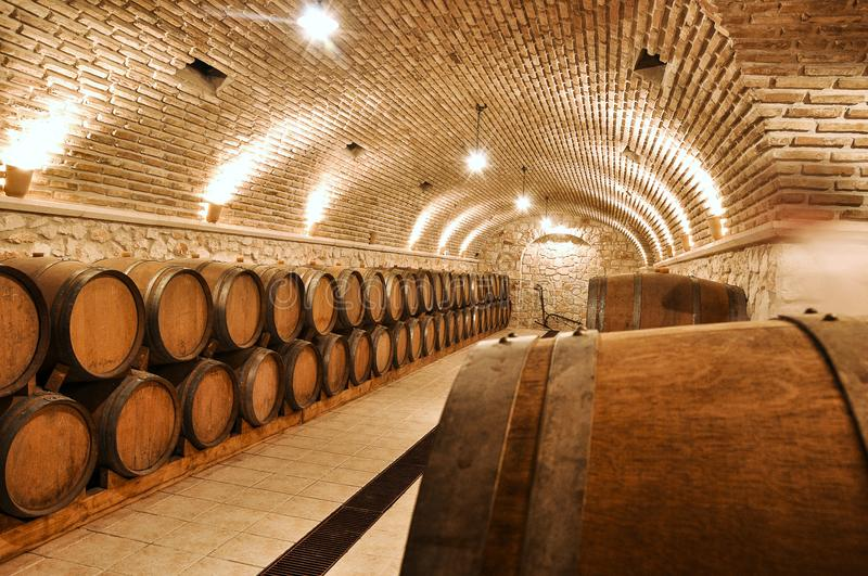 Wine barrels in winery basement. royalty free stock photos