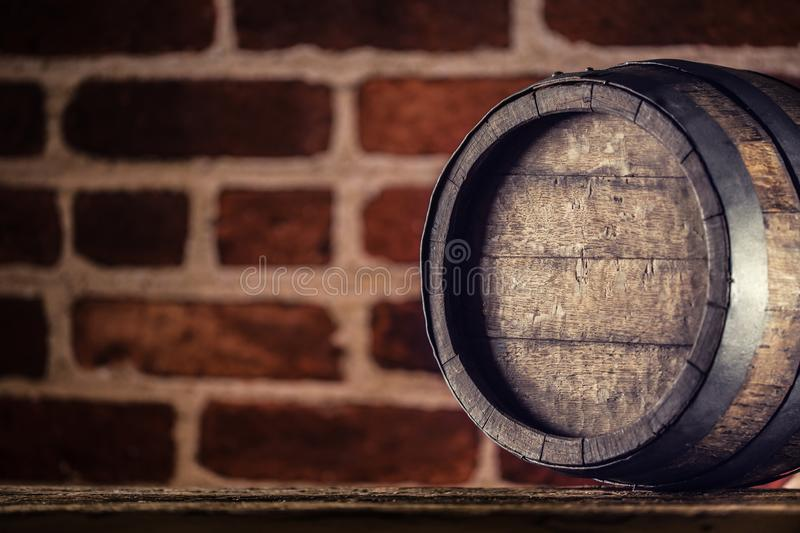 Wine beer cognac whiskey or rum barrel on wooden table royalty free stock photo