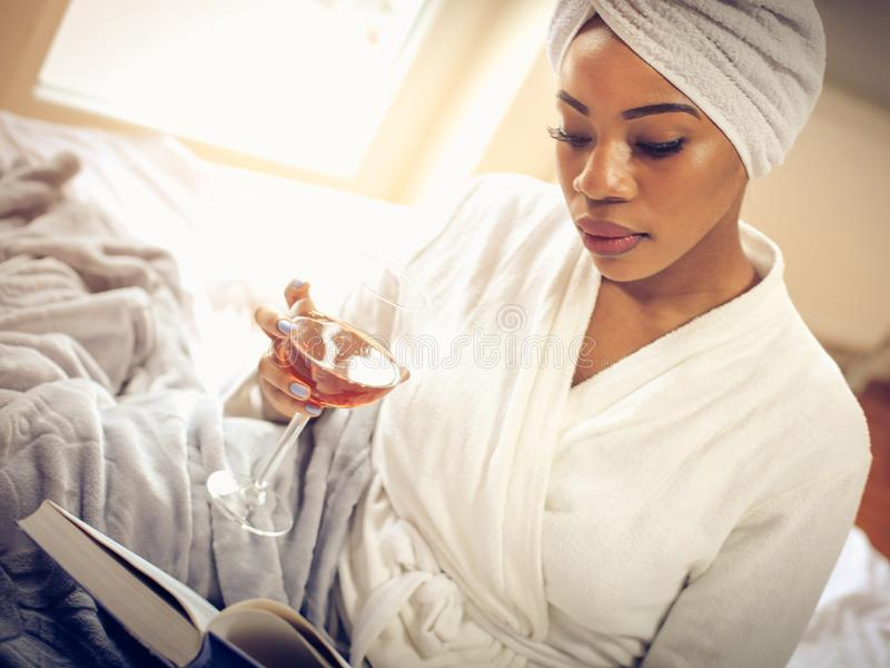Wine and book are a good combination. stock photography