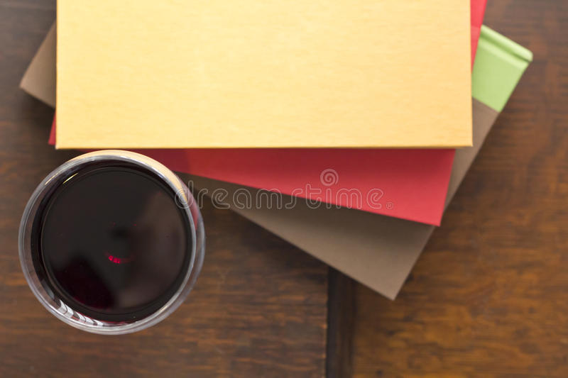 Wine Books. Glass of wine pencils and books in this retro creative writing and relazation themed desk top royalty free stock image