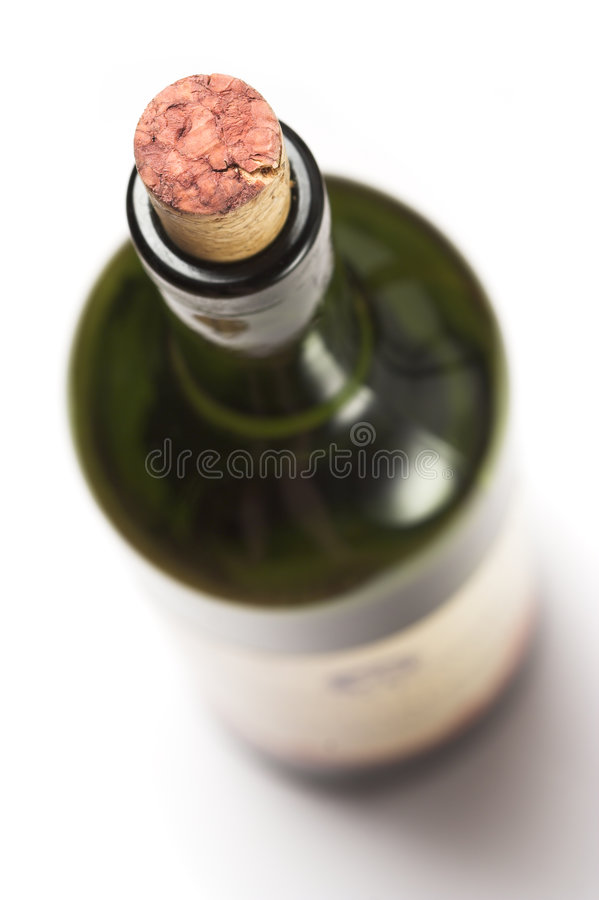 Wine bottle. Bottle with grapes wine, corked. Shallow dof, focus is on the top of the cork stock image