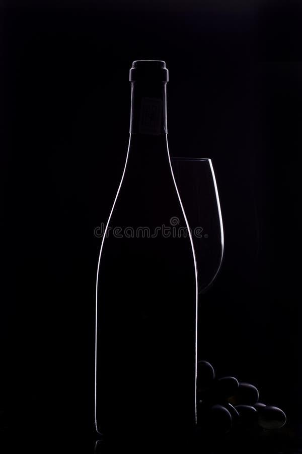 Wine bottle. With white rim light stock image