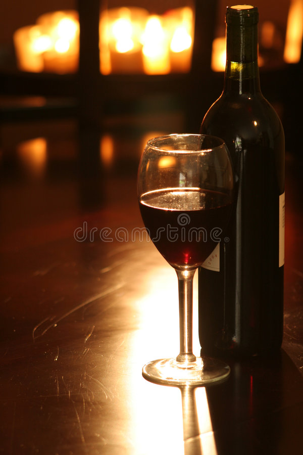 Wine & Bottle with candles royalty free stock photos