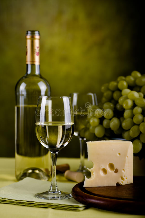 Wine bottle and cheese royalty free stock photography