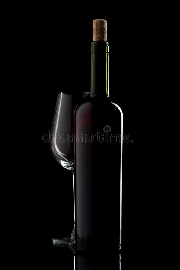 Wine bottle with cork and empty glass royalty free stock image