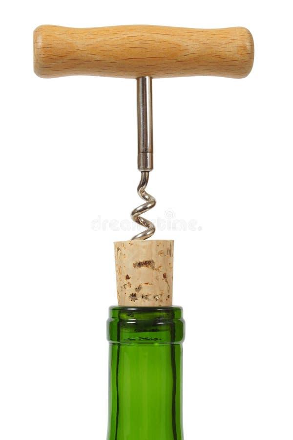 Wine bottle with corkscrew royalty free stock photo