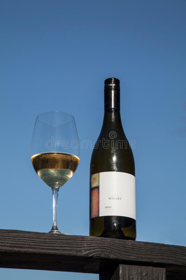 Wine Bottle and Glass royalty free stock photography