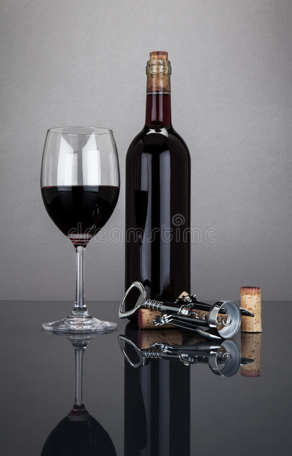 Wine bottle and glass with corckscrew royalty free stock images