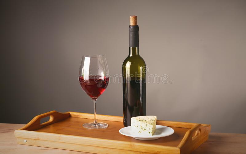 Wine bottle and wine glass on a glass table stock images