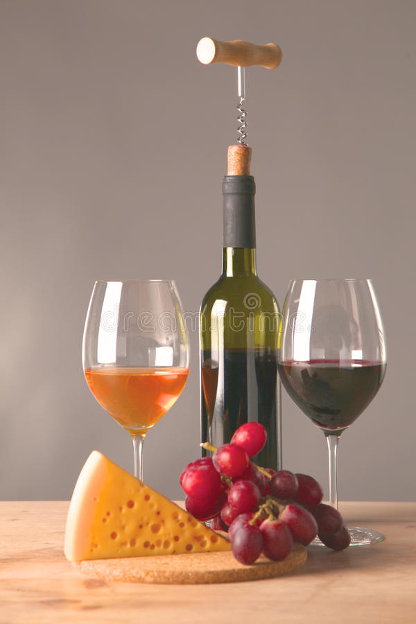 Wine bottle and glass on a table. Wine bottle and wine glass on a glass table stock photo
