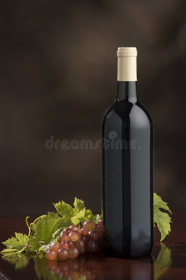 Wine bottle,grapes,grape leaves royalty free stock photo