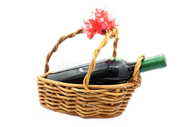 Wine bottle isolated in gift basket on white background royalty free stock images