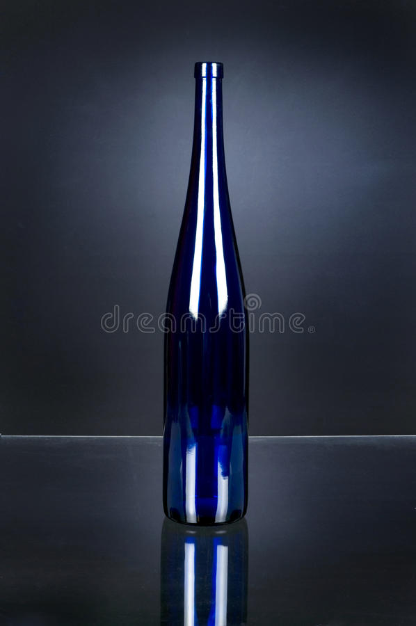Wine bottle without a label. Single branch of the wine bottle stock photography