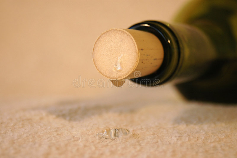 Wine bottle leaking stock photo