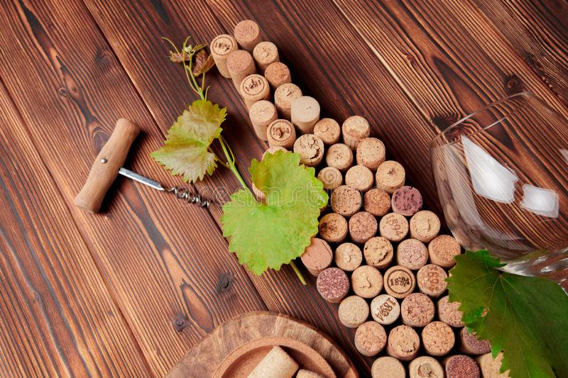 Wine bottle shaped corks and corkscrew over rustic wooden table background and burlap. Top view with copy space - image stock photos