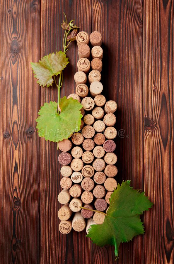 Wine bottle shaped corks and corkscrew over rustic wooden table background and burlap. Top view with copy space - image stock photography