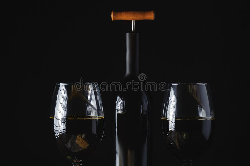 Wine bottle and two glasses royalty free stock photo