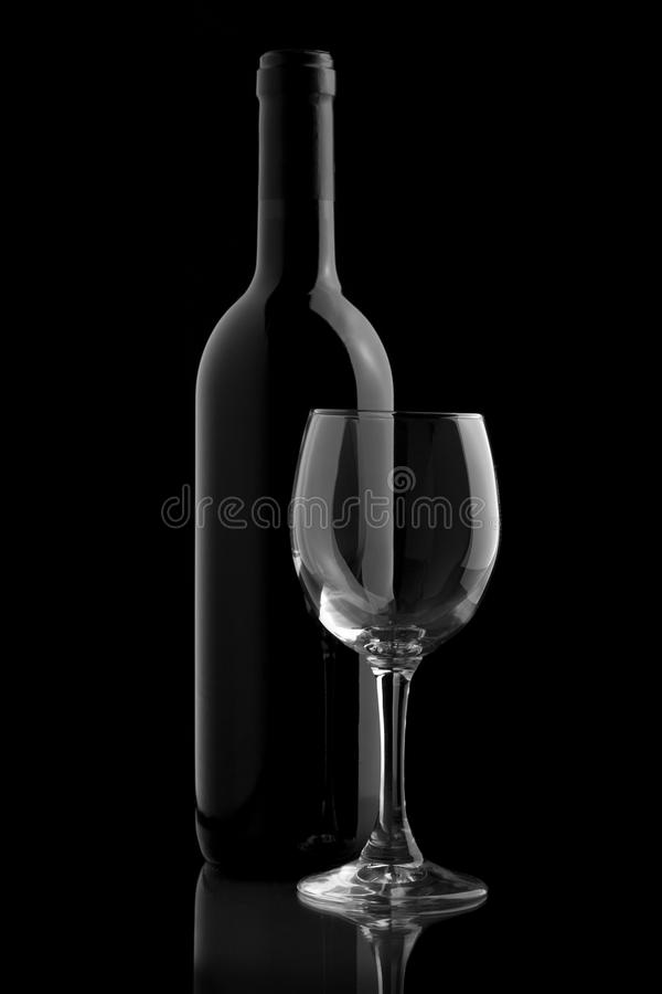 Download Wine Bottle And Wine Glass In A Black Background Stock Photo - Image of black, beverage: 19115582