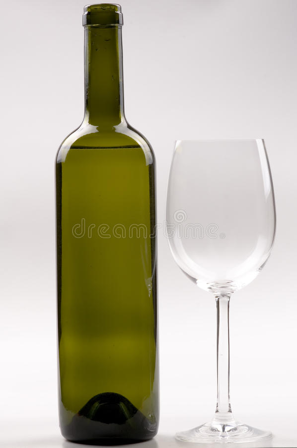 Wine bottle and wineglass stock photos