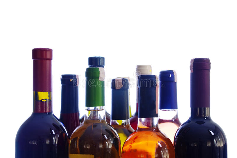 Wine bottles. Various colorful wine bottles isolated over white background stock photography