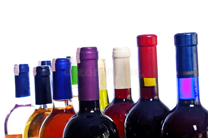 Wine bottles. Various colorful wine bottles isolated over white background stock photos