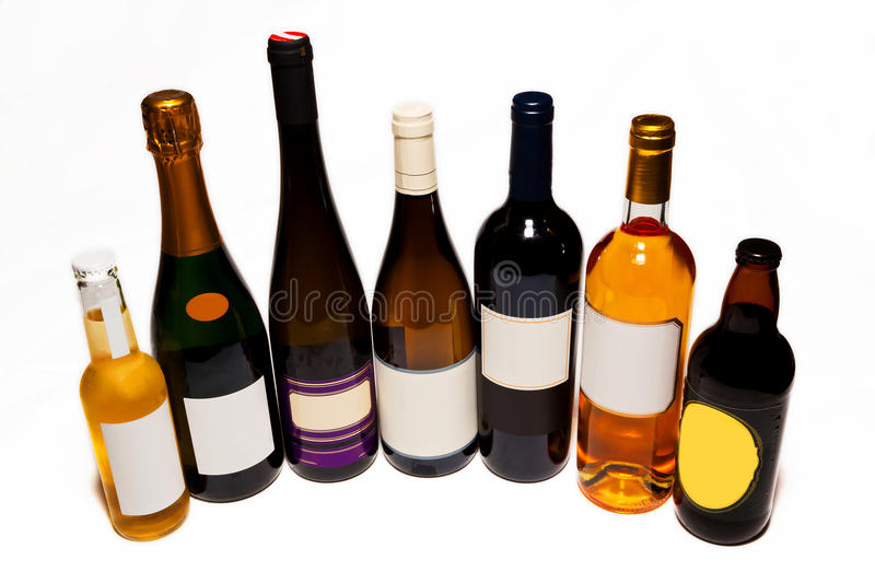 Wine bottles. Several bottles of wine and beer with blank labels, isolated on white background royalty free stock images