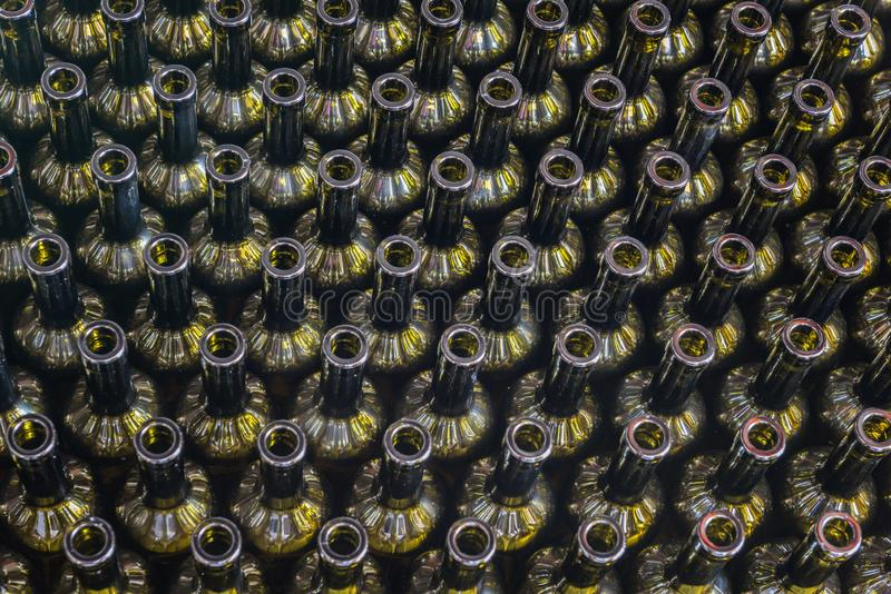 Wine bottles background, winemaking process to preparing wine for bottling in a winery, top view royalty free stock image